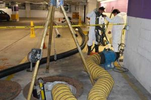 B&P Environmental employees performing confined space work