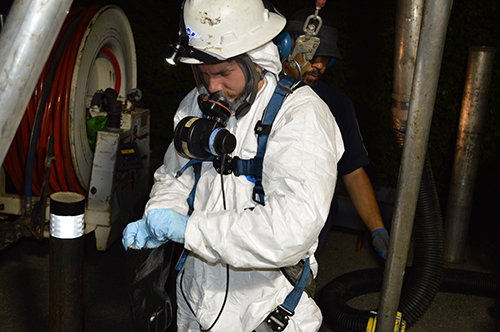 a worker performing pump chamber cleaning