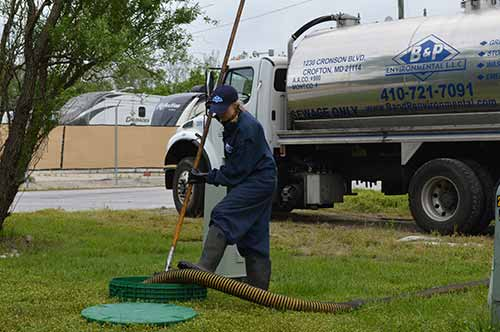 a worker performing septic tank plumbing services